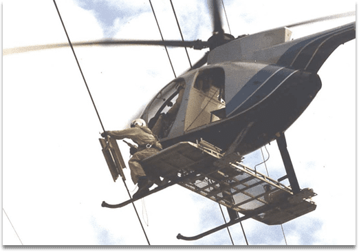 AR Windamper being installed on a transmission line using a helicopter